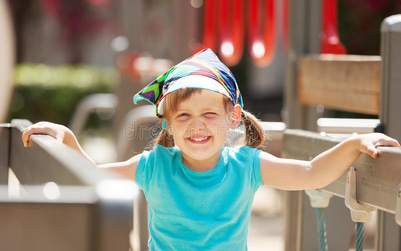 Portrait of laughing three-year girl at playground area royalty free stock photos