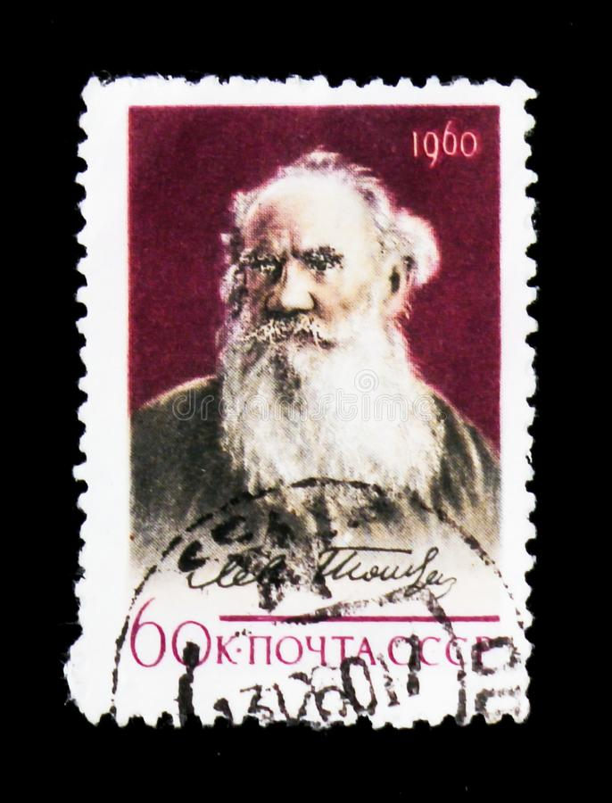 Portrait of Leo Tolstoy - Russian classic writer, 50th Death Anniversary, circa 1960. MOSCOW, RUSSIA - JUNE 26, 2017: A stamp printed in USSR Russia shows stock image