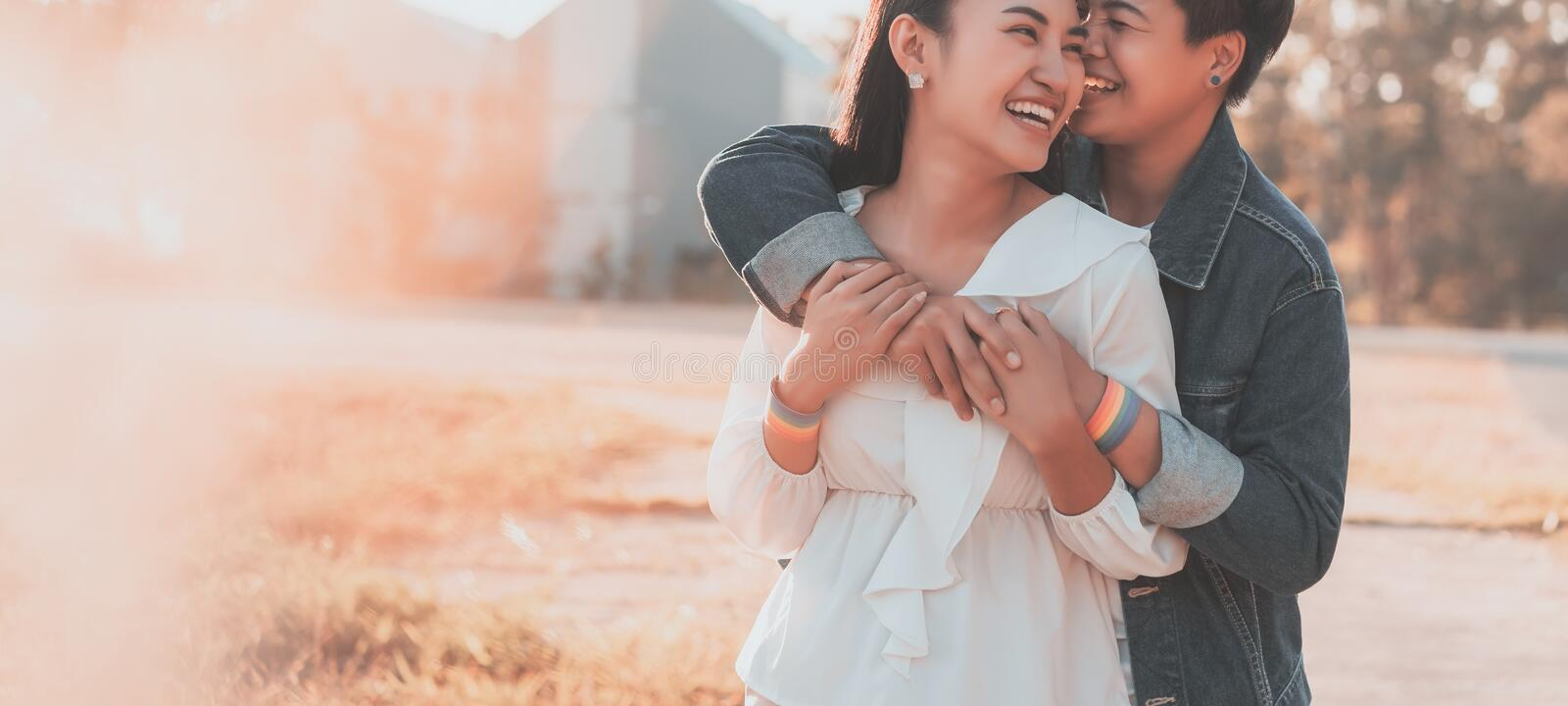 Portrait of Lesbian couple standing and hugging relaxing at sunset. LGBT rights concept royalty free stock images