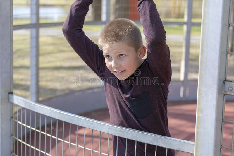 Portrait of a litte blond boy on playground stock photos