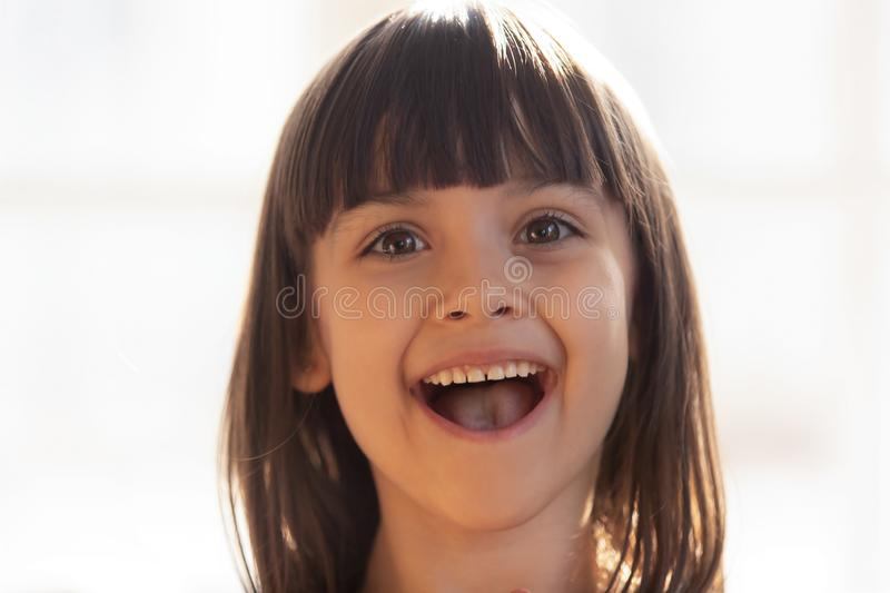 Portrait of little adorable cheerful girl looking at camera royalty free stock photography