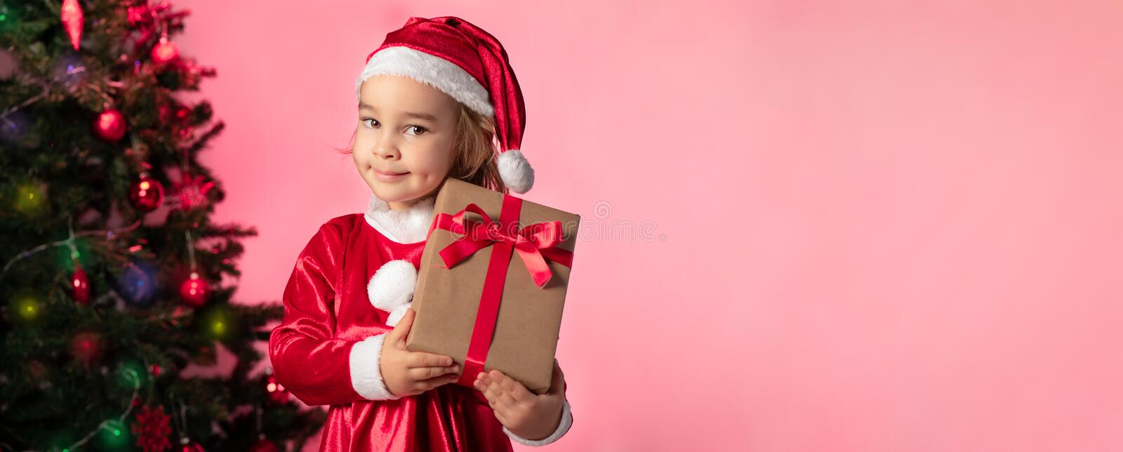 Portrait of Little Adorable Girl in Christmas Costume royalty free stock images