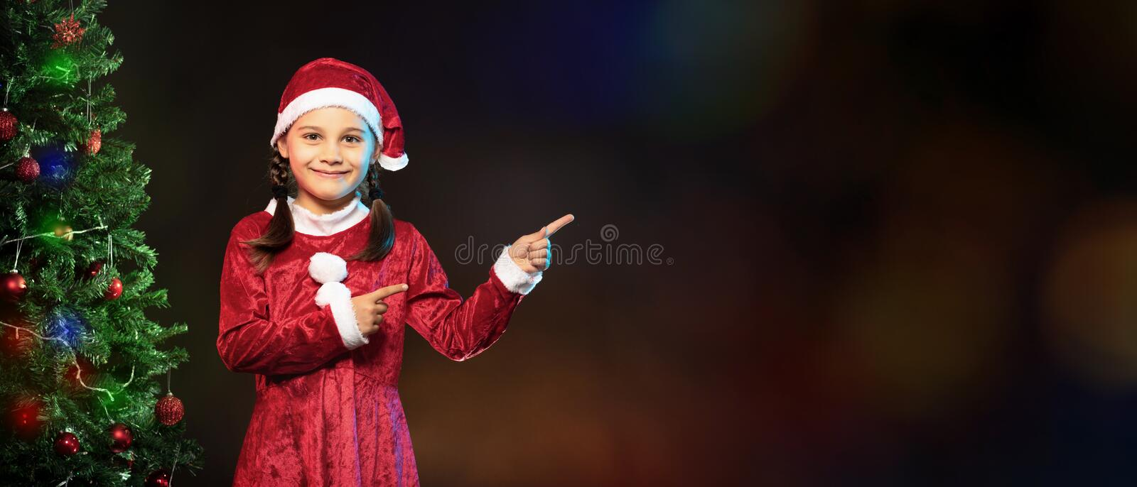 Portrait of Little Adorable Girl in Christmas Costume royalty free stock image