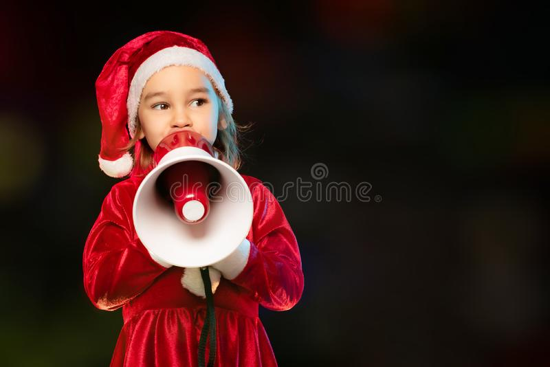Portrait of Little Adorable Girl in Costume Holding Megaphone royalty free stock photos