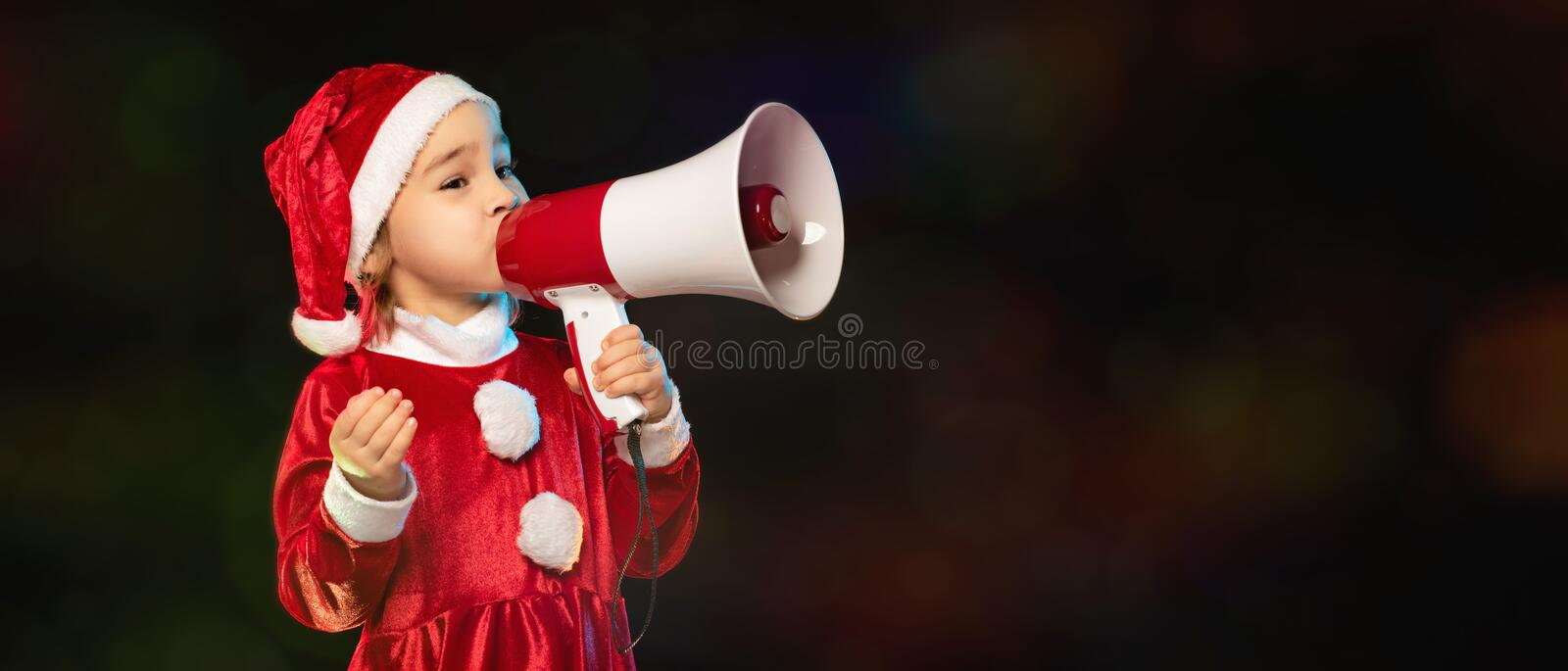 Portrait of Little Adorable Girl in Costume Holding Megaphone royalty free stock photography