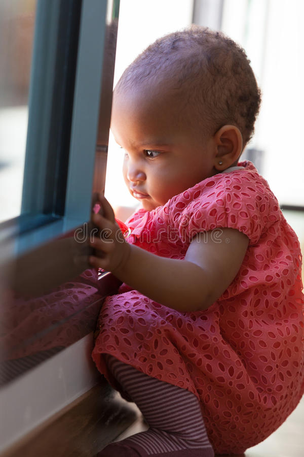 Portrait of little African American little girl sitting - Black royalty free stock image