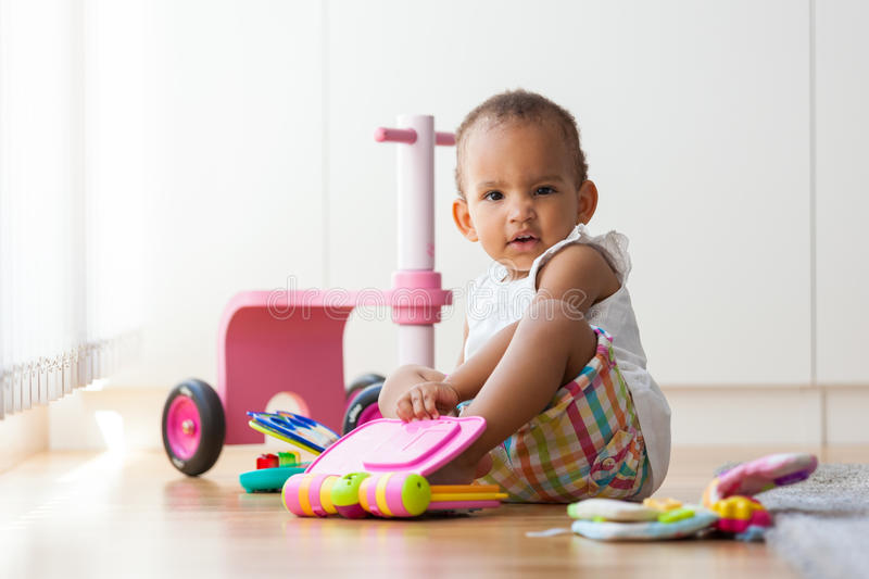 Portrait of little African American little girl sitting on the f royalty free stock photography