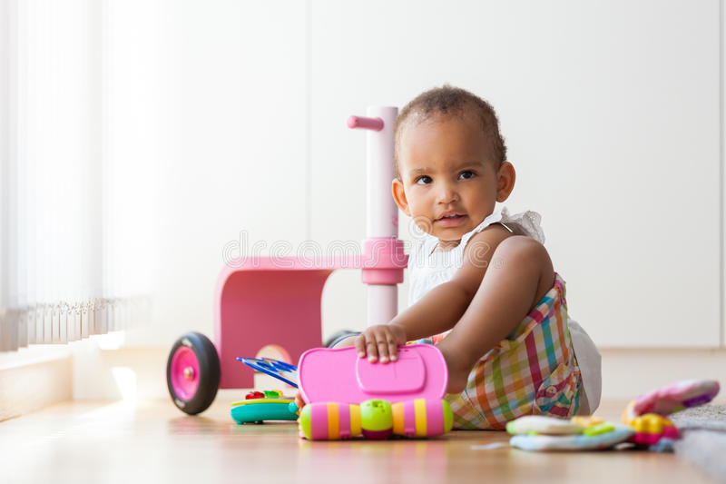 Portrait of little African American little girl sitting on the f royalty free stock photos