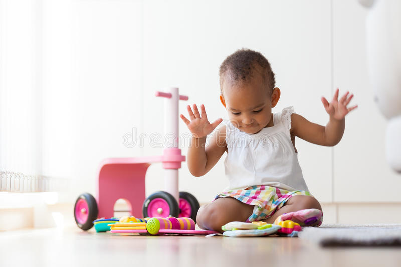 Portrait of little African American little girl sitting on the f stock image