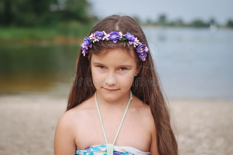 Portrait of a little anxious sad girl in a swimsuit on the beach. Portrait of a little anxious sad girl in a swimsuit on the summer beach, abuse, child, lost stock images