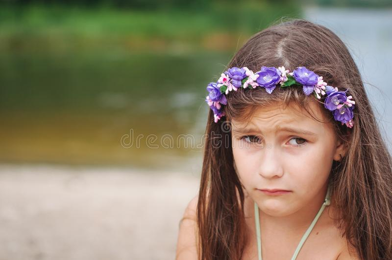 Portrait of a little anxious sad girl in a swimsuit on the beach. Portrait of a little anxious sad girl in a swimsuit on the summer beach, abuse, child, lost royalty free stock photos