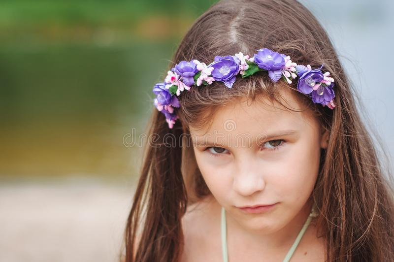 Portrait of a little anxious sad girl in a swimsuit on the beach. Portrait of a little anxious sad girl in a swimsuit on the summer beach, abuse, child, lost stock photo
