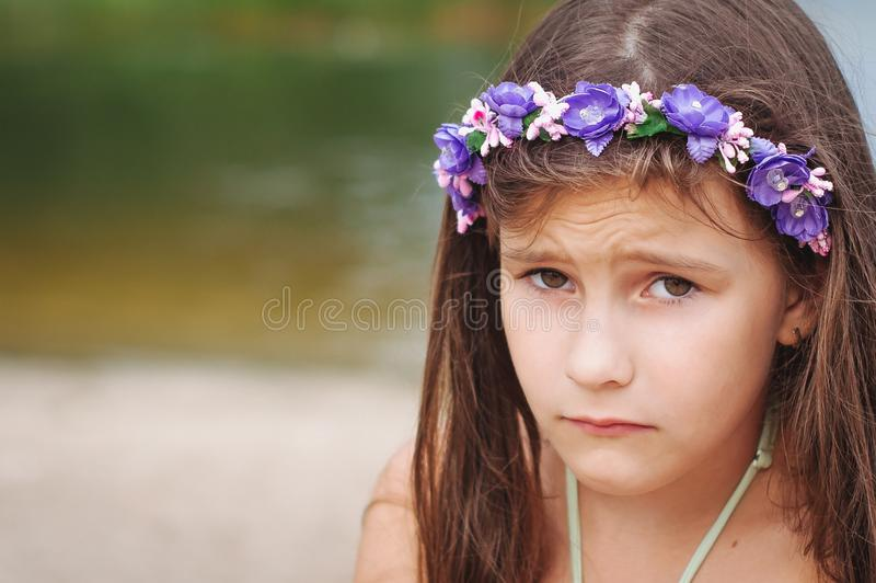 Portrait of a little anxious sad girl in a swimsuit on the beach. Portrait of a little anxious sad girl in a swimsuit on the summer beach, abuse, child, lost royalty free stock images
