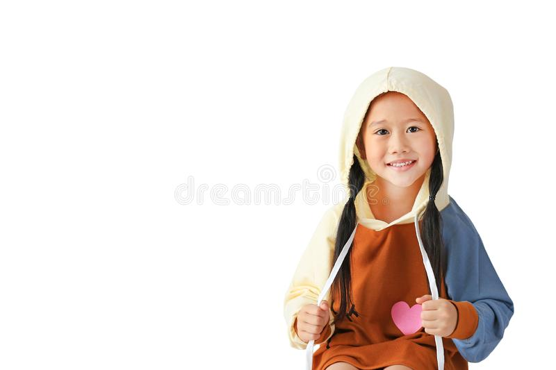 Portrait of little Asian child girl in hood on head warm clothes with pull the rope isolated on white background with copy space.  royalty free stock photos