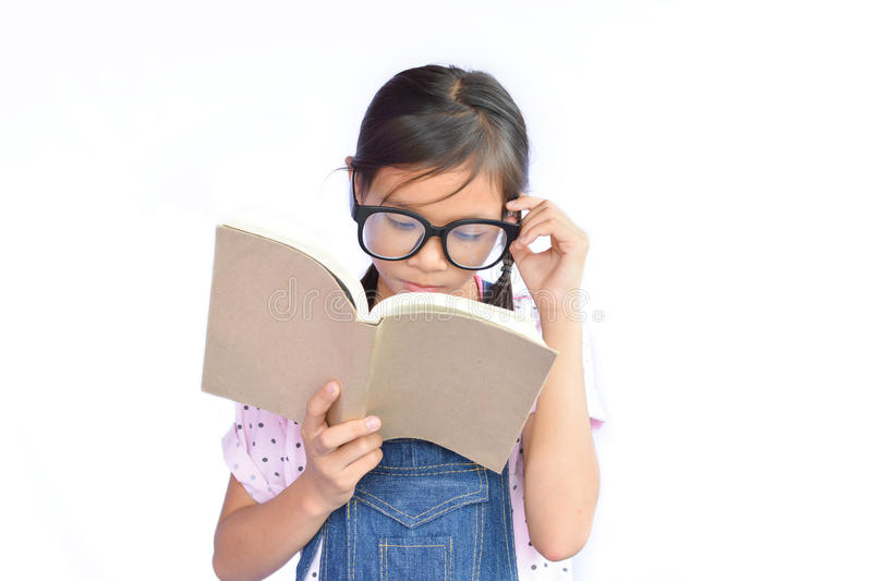 Portrait of little Asian girl reading a book on white royalty free stock photos