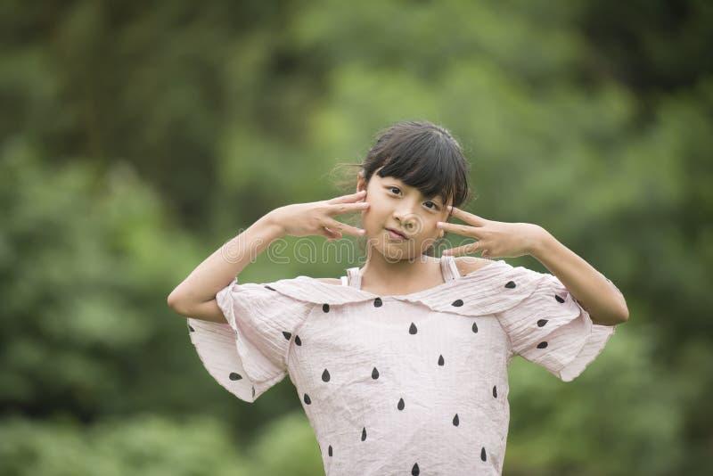 Portrait of Little Asian Girl Show Emotion stock photos