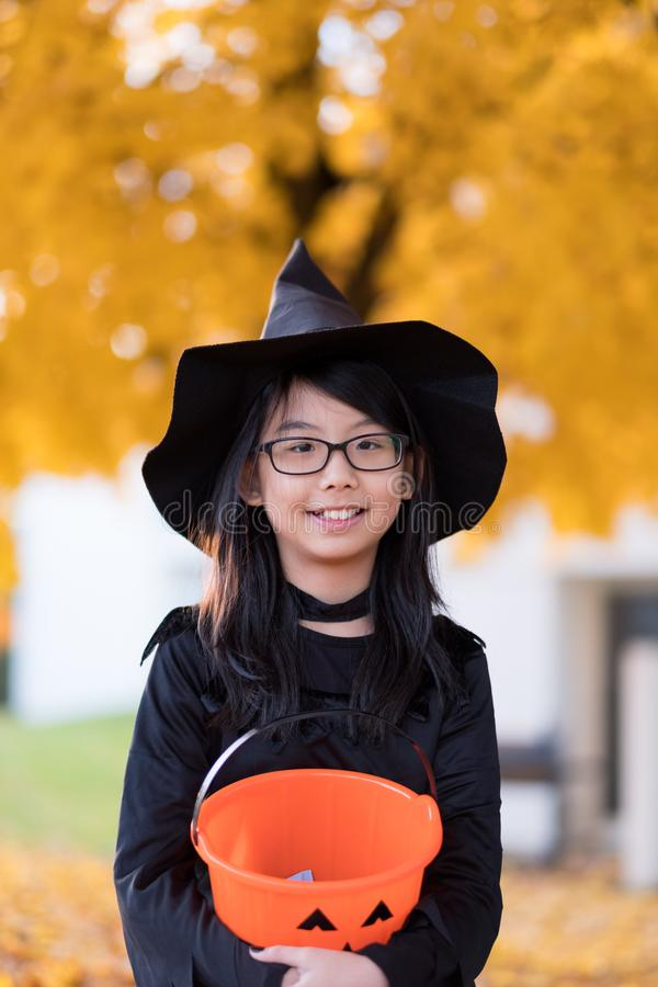 Portrait of little asian girl in witch costume royalty free stock photos