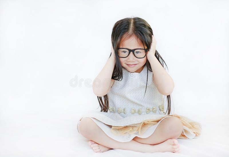 Portrait of little Asian kid girl wearing glasses against white background stock photos