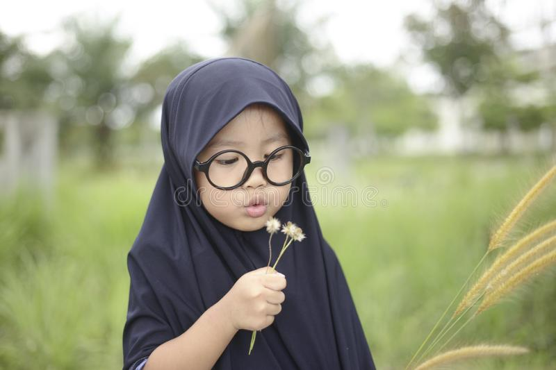 Little Asian Muslim Girl Playing in the Park stock images