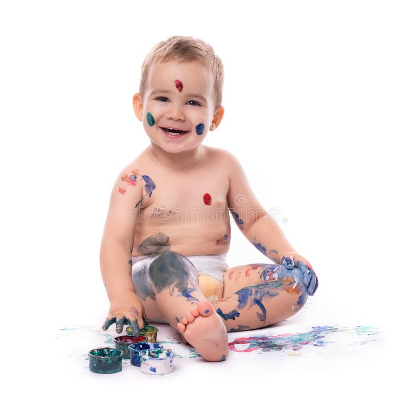 Portrait of  Little Baby Boy Playing with Paints royalty free stock photo