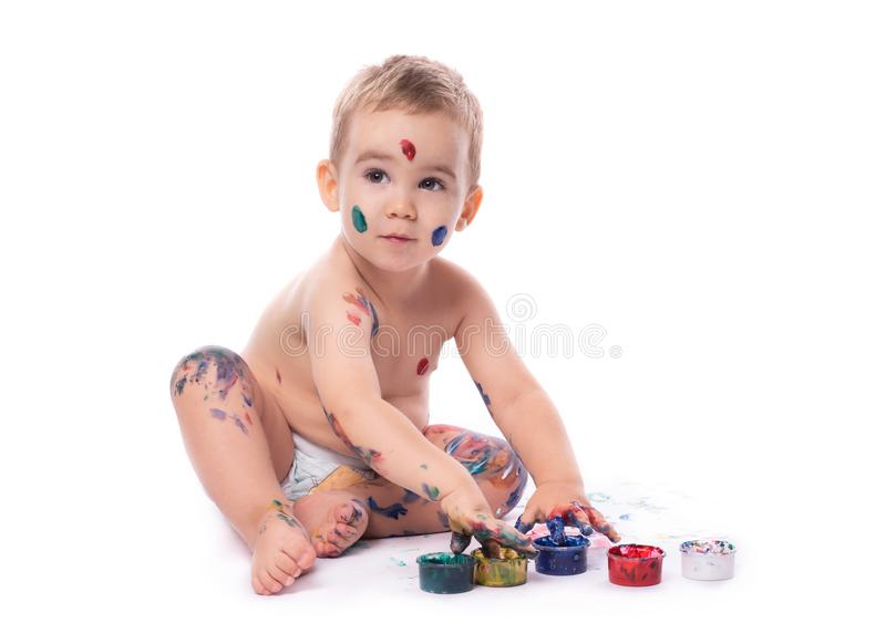 Portrait of  Little Baby Boy Playing with Finger Paints royalty free stock photos