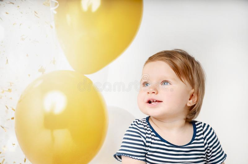 Portrait of little baby girl smiling on the day of birth stock photo