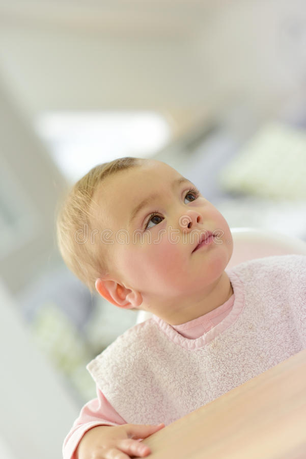 Portrait of little baby girl waiting for food royalty free stock images