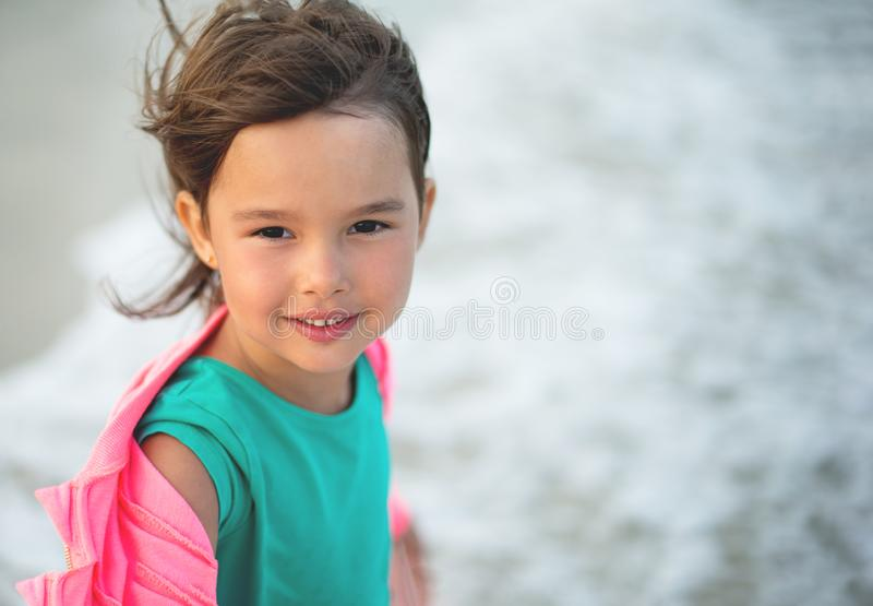 Portrait of little and beautifull girl smilling and havingf royalty free stock image
