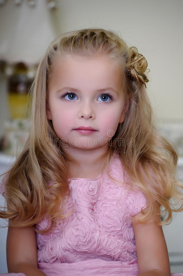 Portrait of a little blond girl. With blue eyes royalty free stock photography