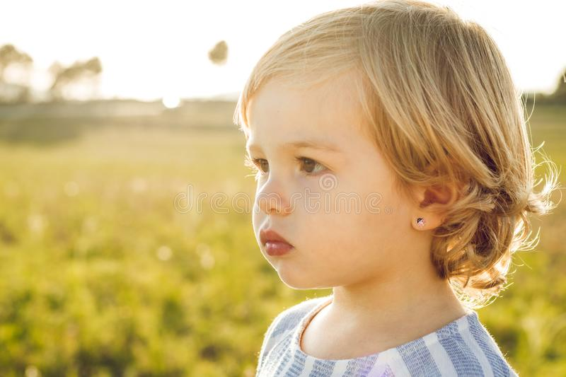 Portrait of a little blonde girl stock image
