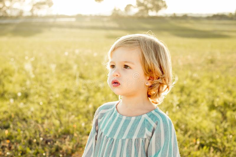 Portrait of a little blonde girl stock images