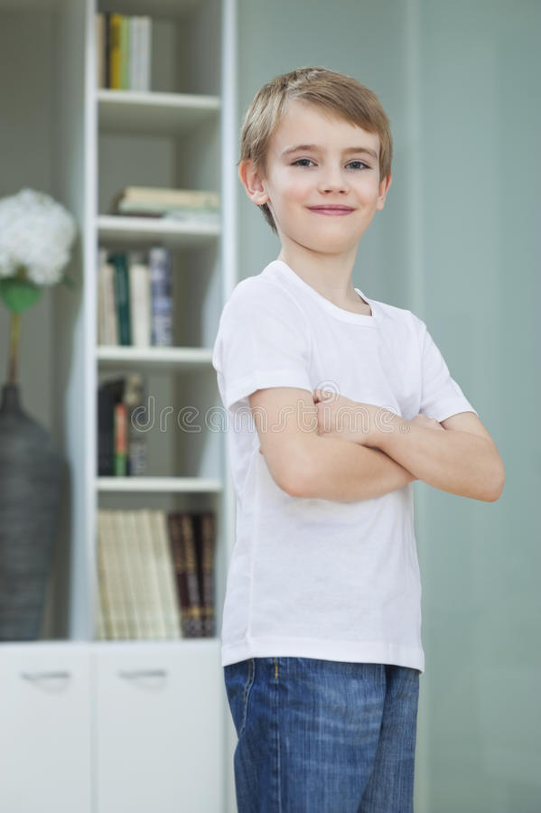 4 Year Boy Bedroom Decorating Ideas: Portrait Of Little Boy In Casuals Standing With Arms