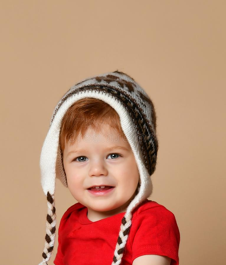 Portrait of Cute smiling baby boy in knitted hat royalty free stock photo