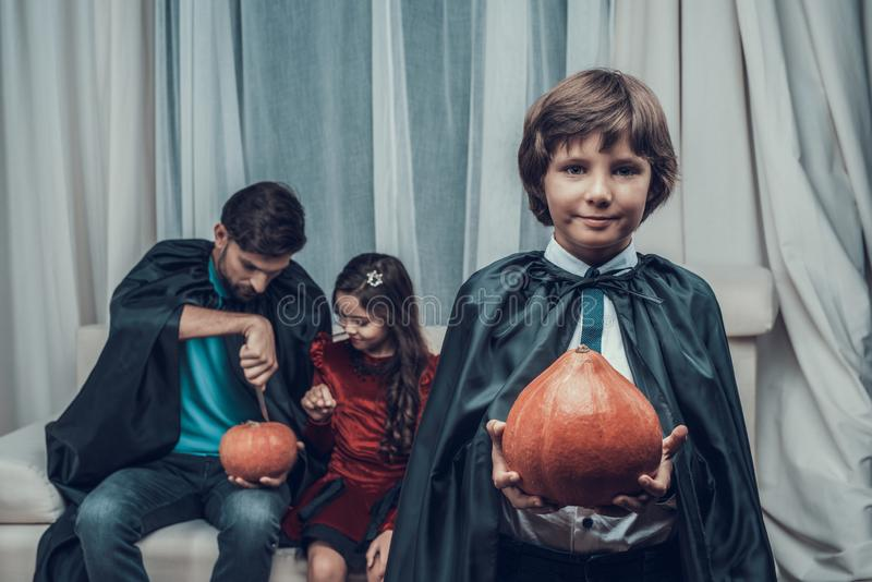 Portrait of Little Boy in Costume holding Pumpkin royalty free stock photography