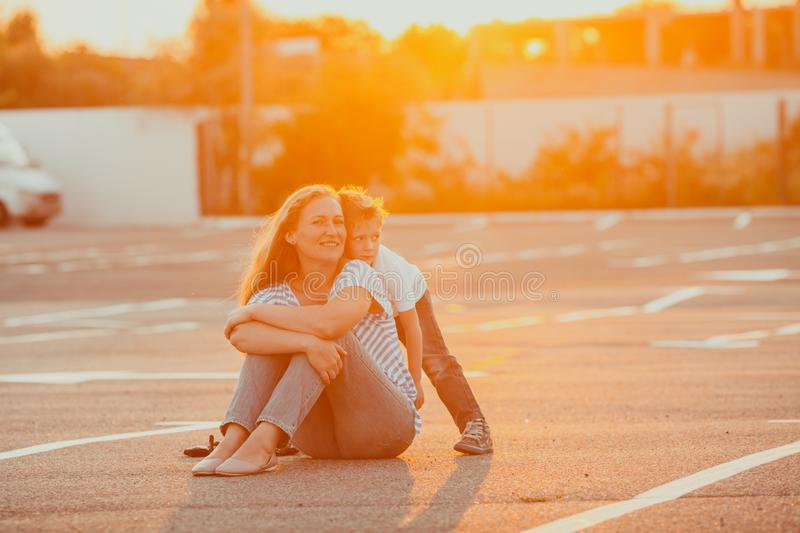Portrait of little boy embracing his mother royalty free stock photo