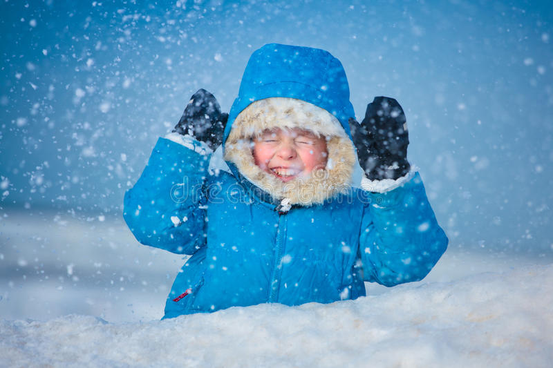 Portrait of a little boy outdoors in the snow