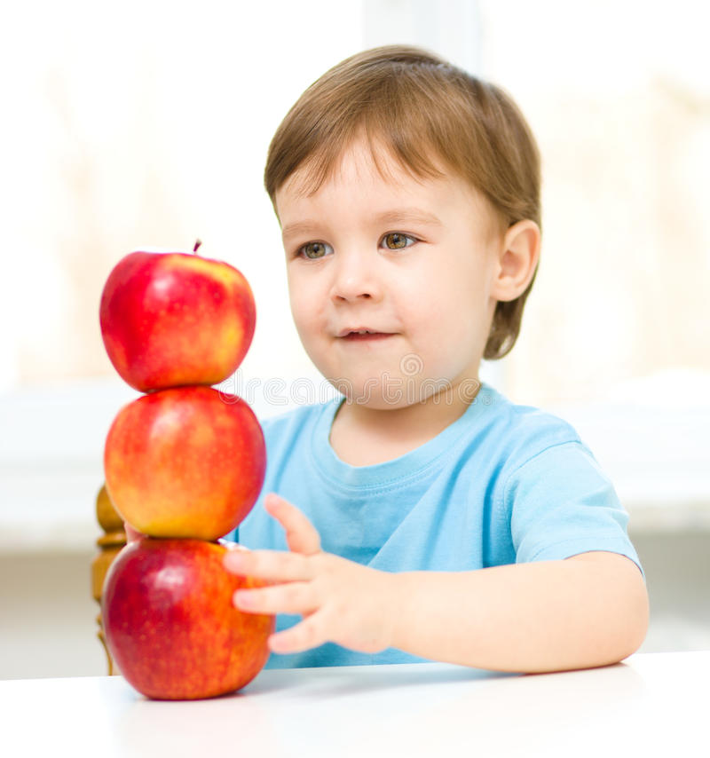 Portrait of a little boy with apples stock photos