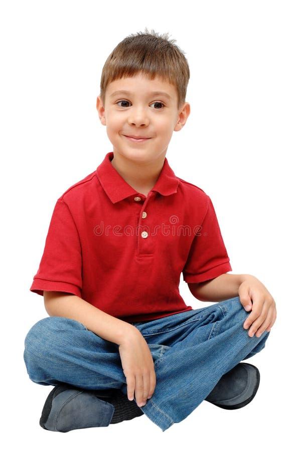 Portrait of little boy sitting on floor stock photos