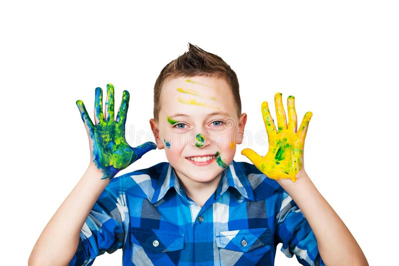 Portrait little boy smeared hands in paint. Isolated on white background royalty free stock photo