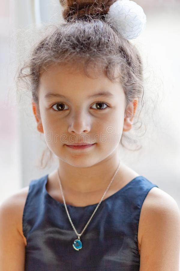 Portrait of little brown-eyed Muslim girl stock images