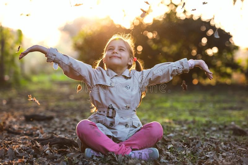 Portrait of Little Child Girl in Autumn in Park stock photography