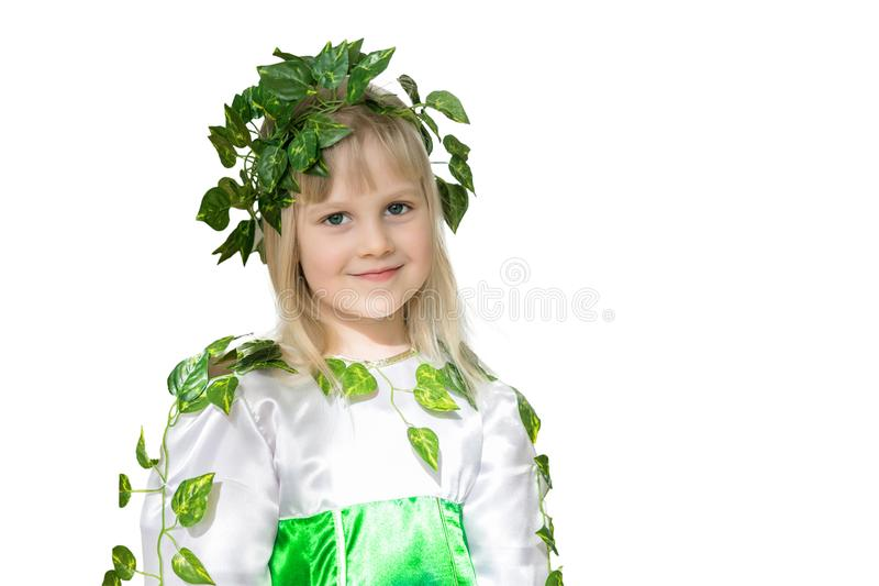 Portrait of little cute girl. Baby in spring forest fairy dress with wraith of leaves. Kid as character of nature. Isolated on whi stock images