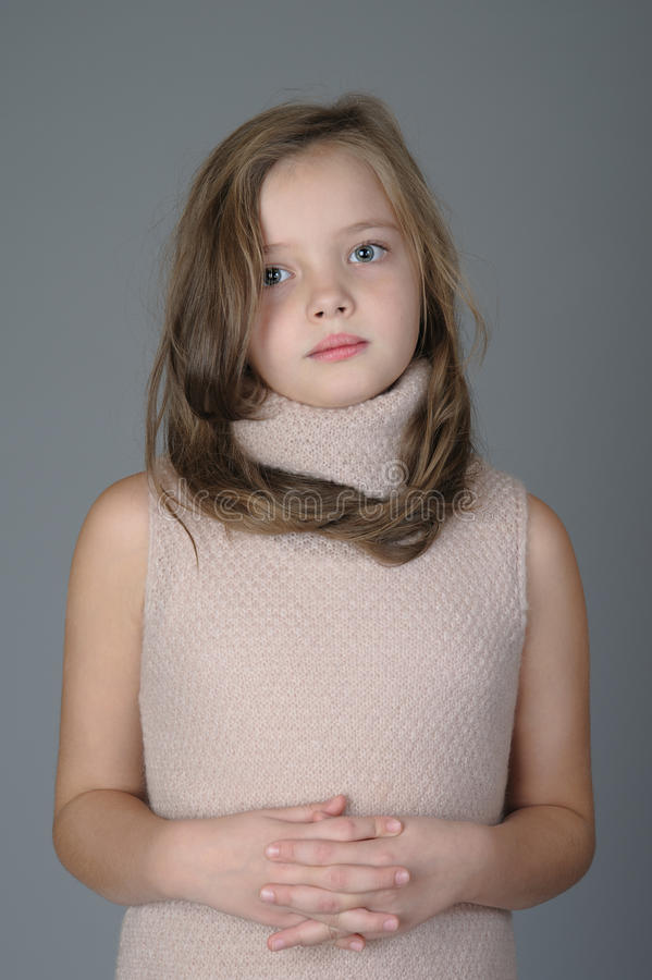 Portrait of little cute girl with a calm expression on her face. stock photos