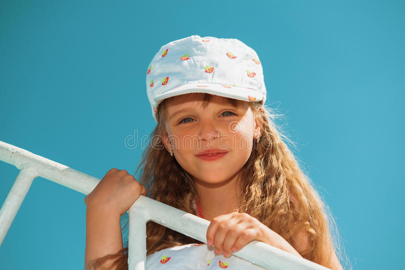 Portrait of little cute girl enjoying playing on boat stock images