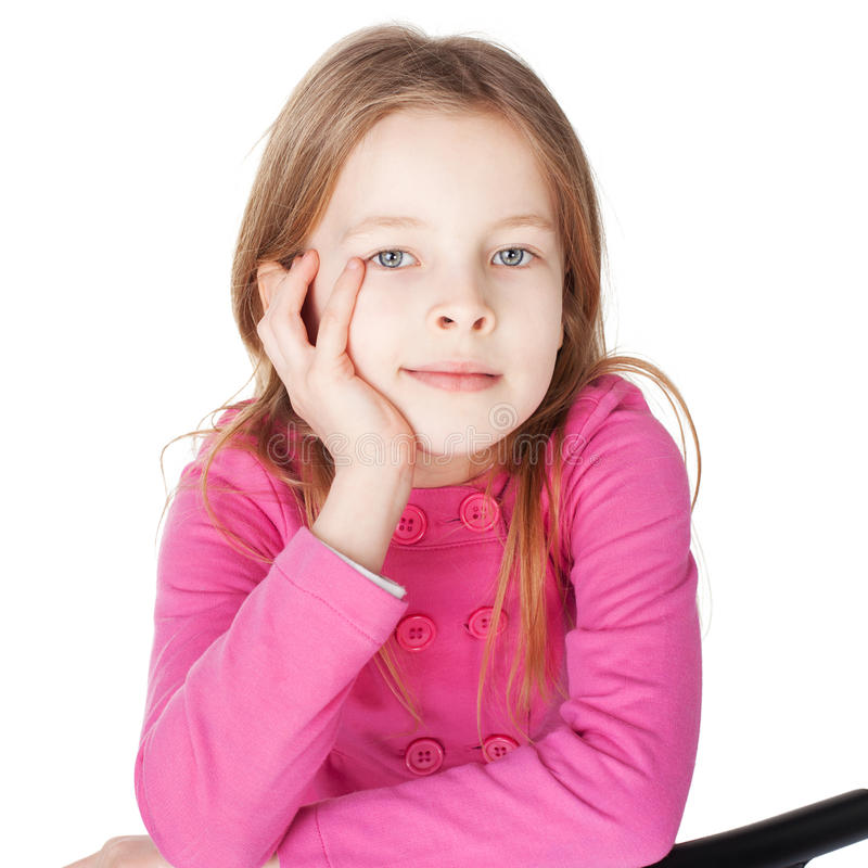 Portrait of little girl. Sitting her chin on hand isolated on white background royalty free stock photography