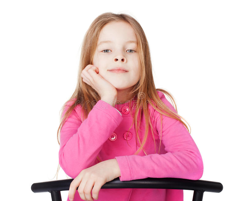 Portrait of little girl. Sitting her chin on hand isolated on white background stock photography