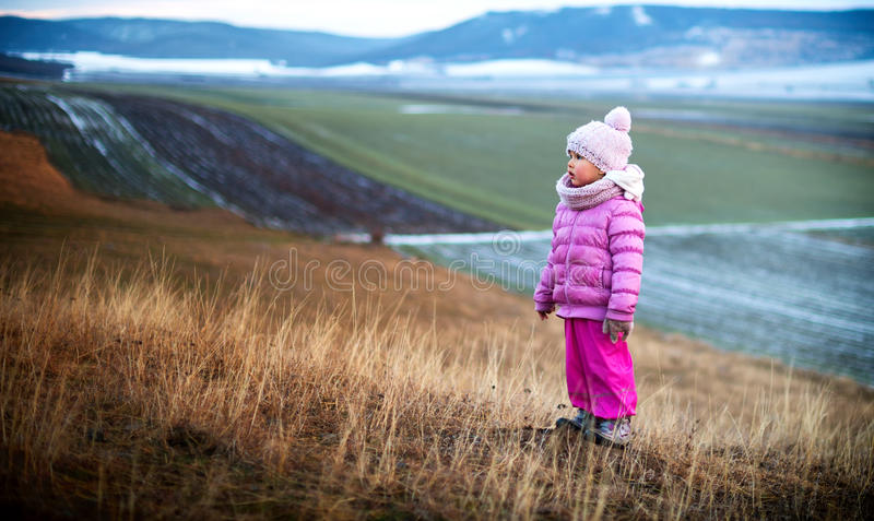 Portrait of a little girl alone in the field royalty free stock image