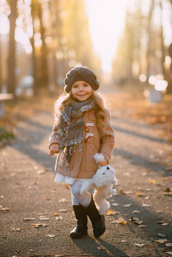 Portrait of little girl on background of autumn city royalty free stock photos