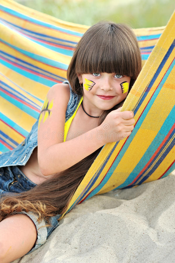 Portrait of little girl. On the beach stock images