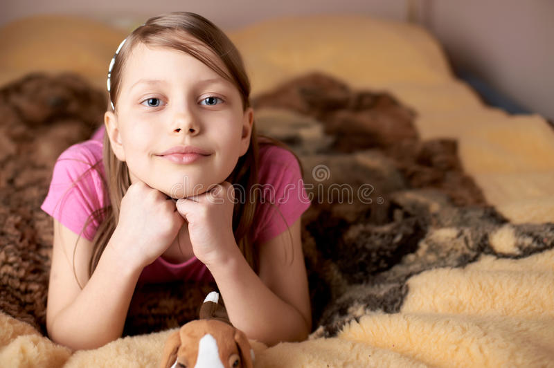 Portrait of a little girl in bed